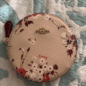 Coach round coin case with floral bundle print.